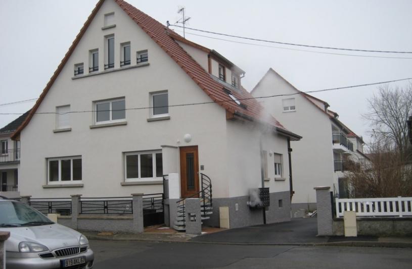 L'ensemble de l'opération, l'ancienne  villa agrandie et restaurée au premier plan