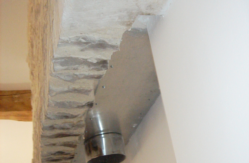 un conduit de cheminée transformé pour un poele