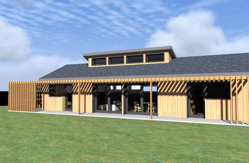 La façade sud est largement vitrée. Une pergola permet de gérer les apports solaires selon la saison