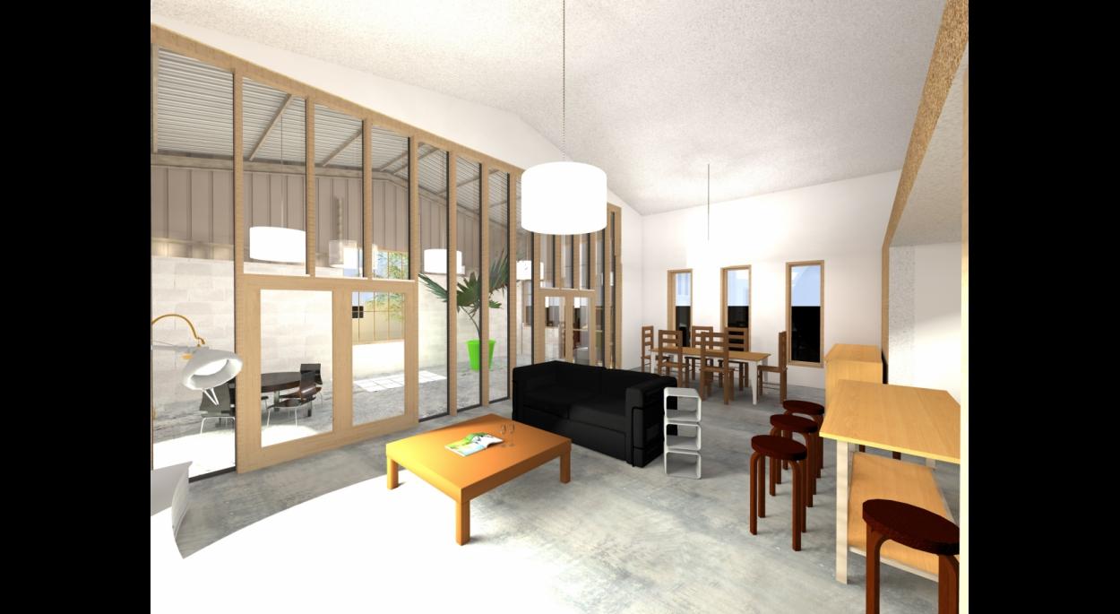 Un vaste salon ouvert sur un atelier