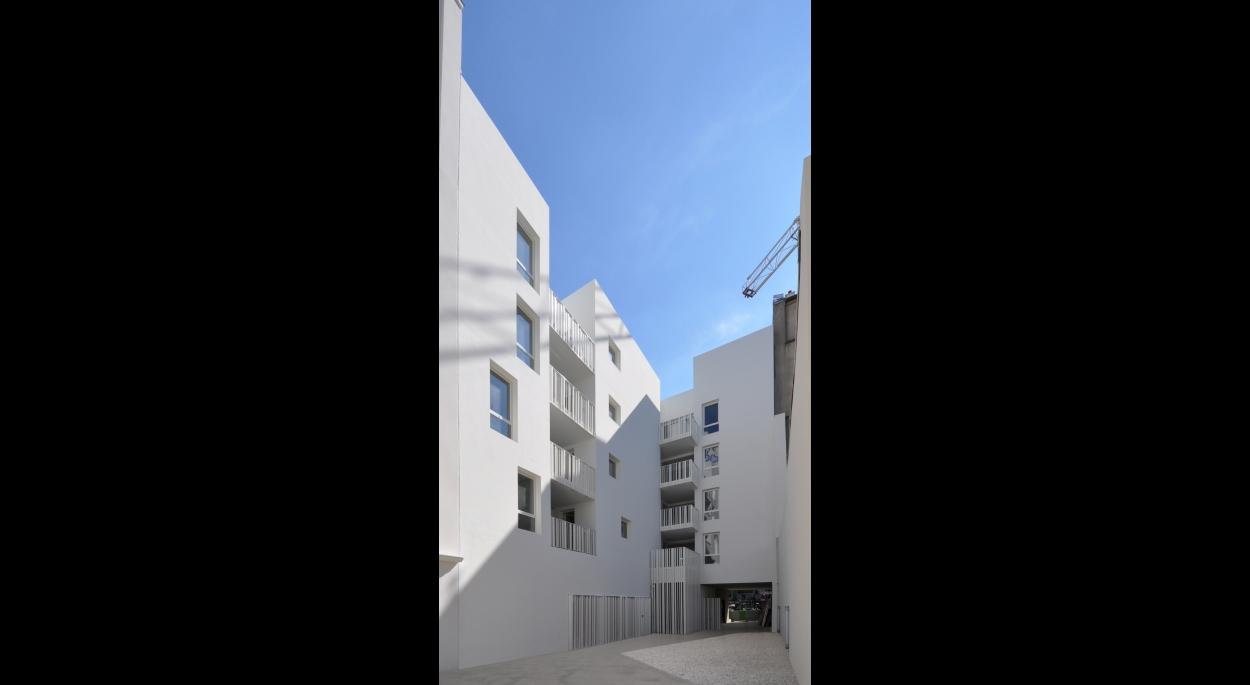 18 logements sociaux - Façade sur cour