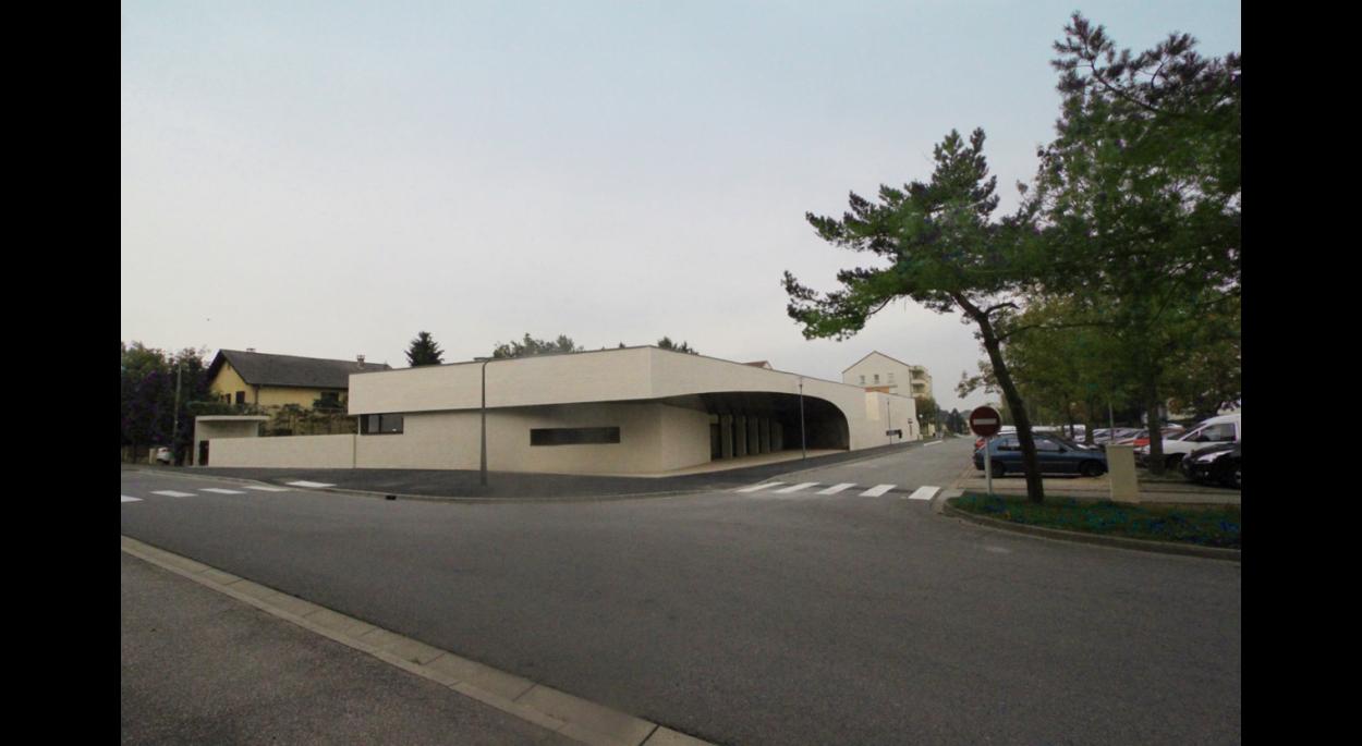 Restaurant scolaire accueil périscolaire : le parvis, une voute en corten dans une façade en brique