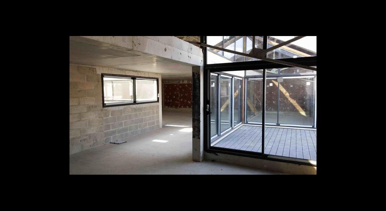 Aménagement loft plateau brut