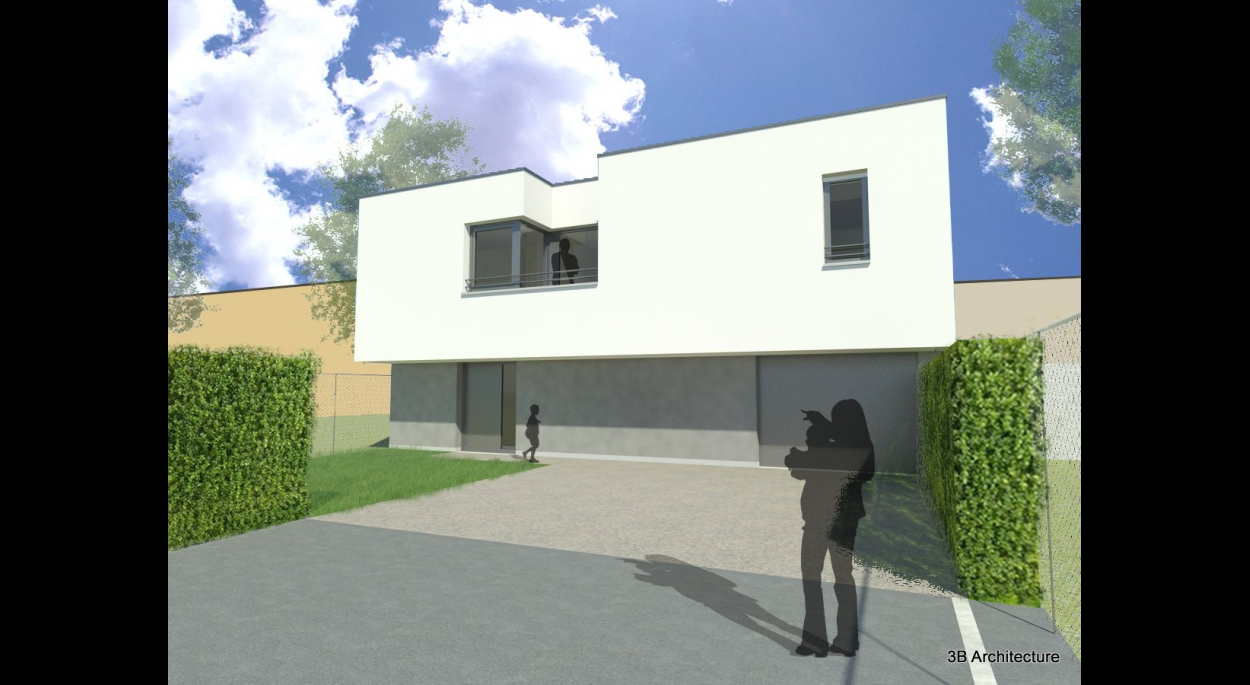 Le coeur du terrain voit s'implanter en deuxieme corps de bâtiment une maison individuelle avec son jardin avant et sa cour.