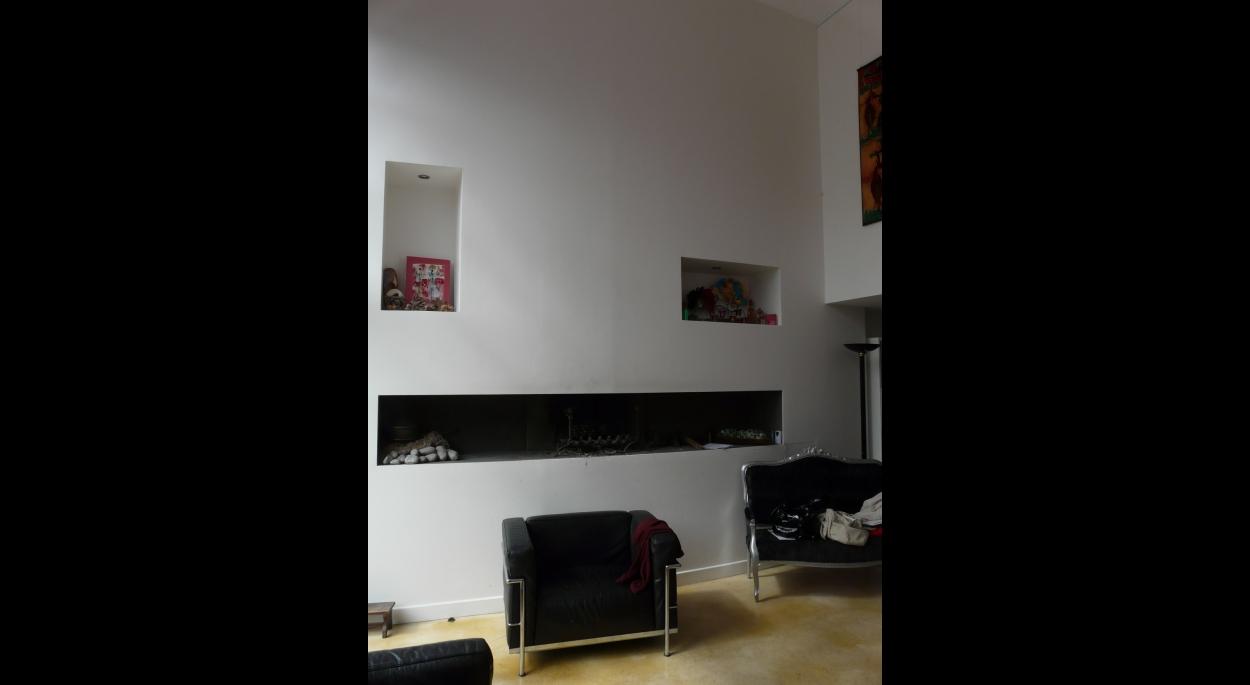 Traitement d'une cheminée dans l'épaisseur du mur