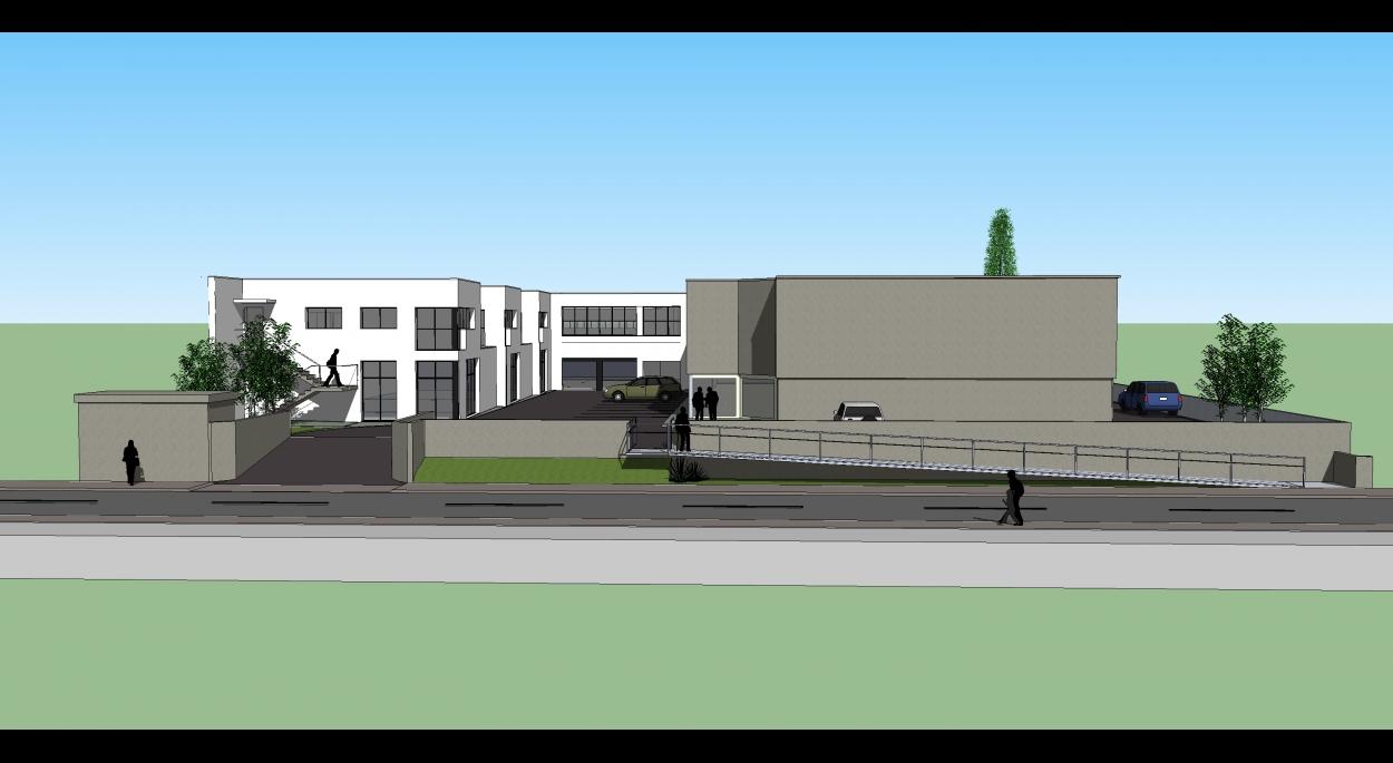 La facade sur rue évite le bâtiment-objet posé au milieu du terrain et invite le chaland à entrer.