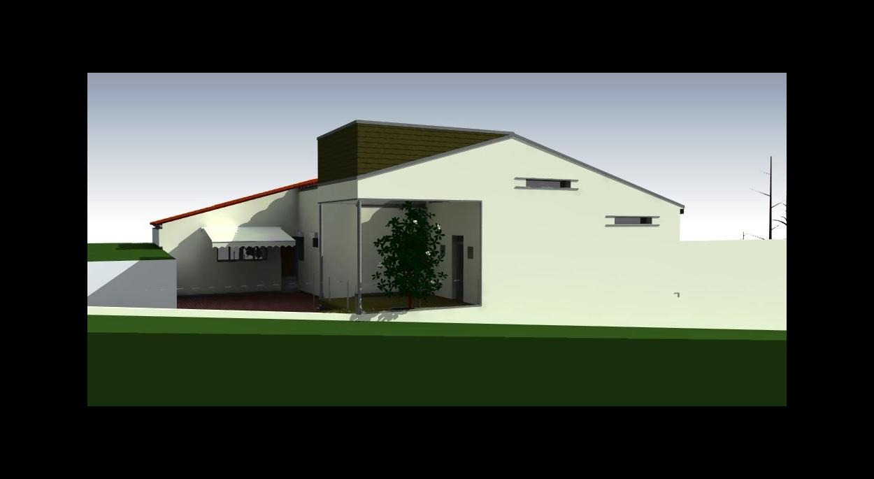 L'extension ne fait pas vraiment la largeur du pignon de la maison existante. Un porche est surmonté de panneaux réfléchissant la lumière vers la fenêtre du séjour existant et donnant lui aussi sur ce porche.