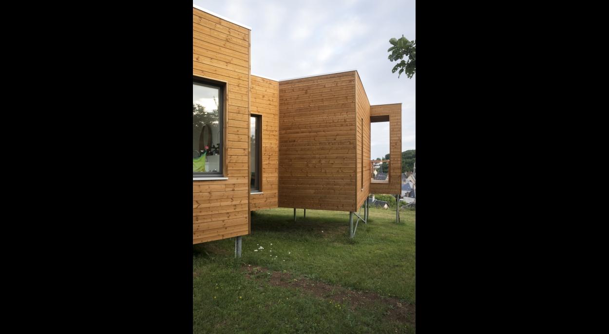 Maison bois bioclimatique sur pilotis