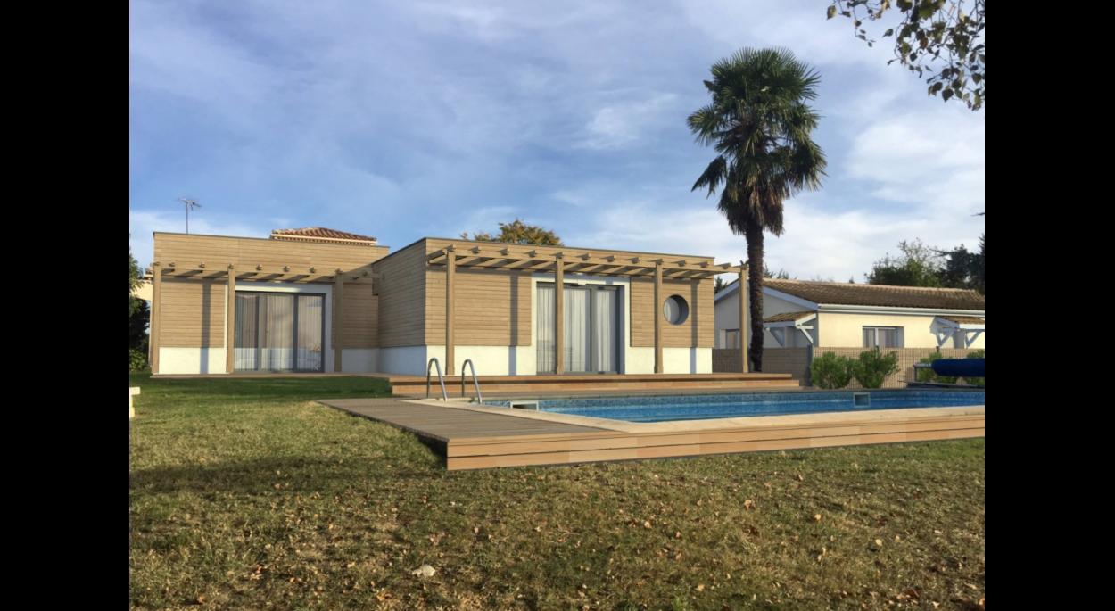 Extension d'une maison d'habitation et création d'un patio autour d'un arbre existant