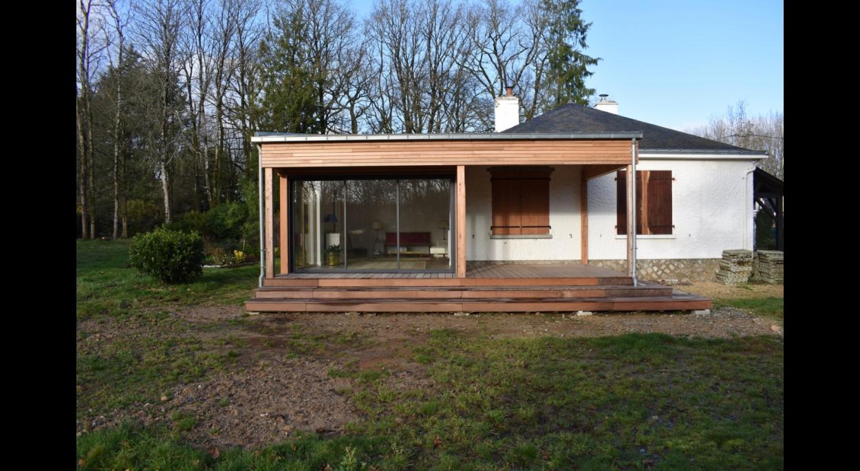 La construction neuve en ossature bois  menuiseries mixte bois/alu laqué.