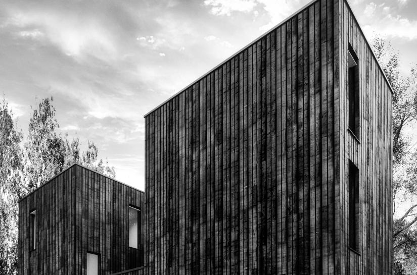 Maison contemporaine à ossature bois - Façade en bois brulé